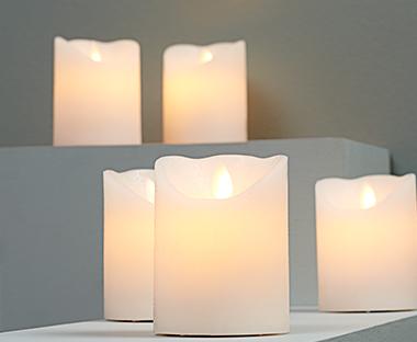 Licht Roze Kaarsen : Kaarsen en servetten sfeervol dineren met kaarsen en servetten