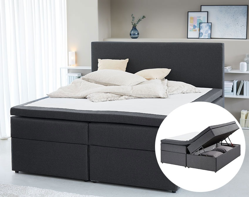 Continental bed with a compartment at the bed base for extra duvets and pillows