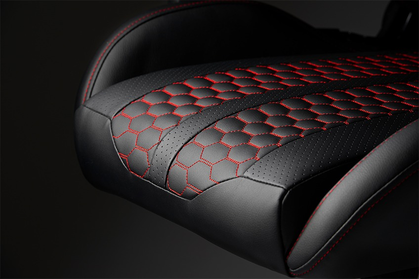 The seat of a black gaming chair