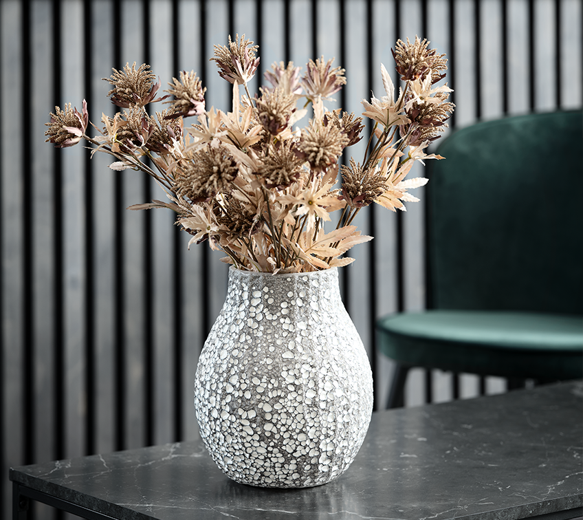 Vase with artificial flower arrangement decorating a living room