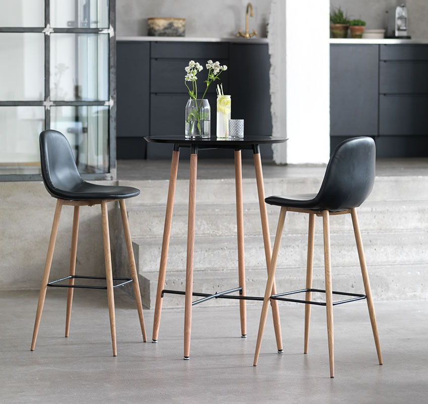 A set of bar stools and table in black and oak